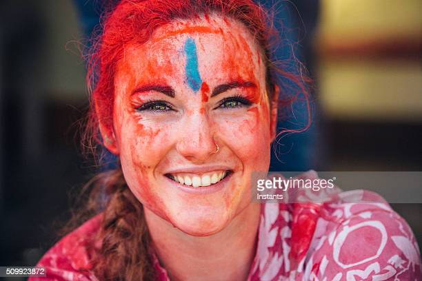 Young woman celebrating Holi Day