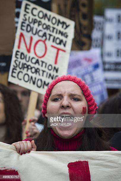 A young woman chants as she walks down Whitehall during the annual demonstration against student fees in central London on November 4 2015 Students...