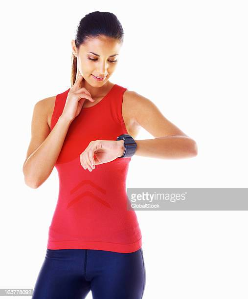 Young woman checking her pulse
