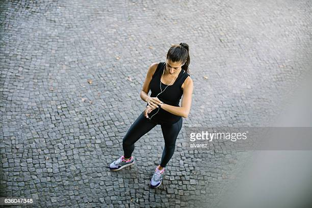 Young woman checking his smart watch