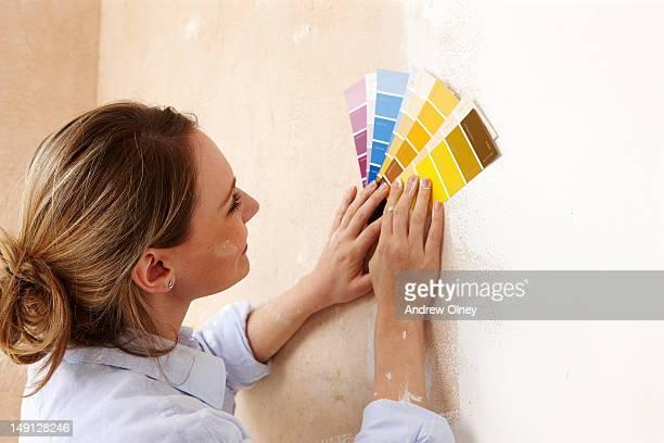 young woman choosing colour scheme