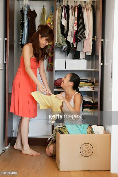 Young woman cleaning out closet