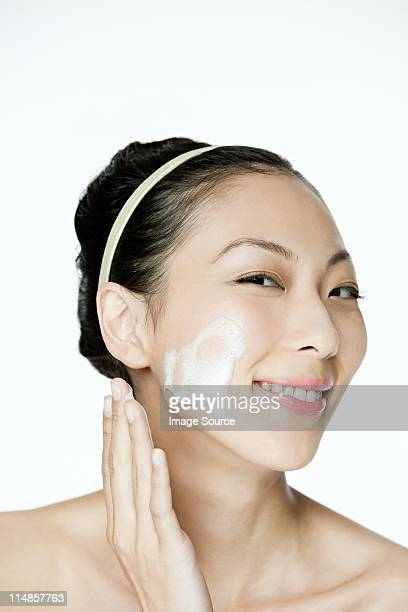Young woman cleansing her face