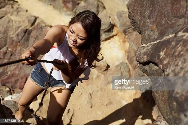 Young woman climbing rocks,  Palos Verdes,  California,  USA