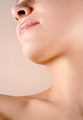 Young woman, close up of neck and chin