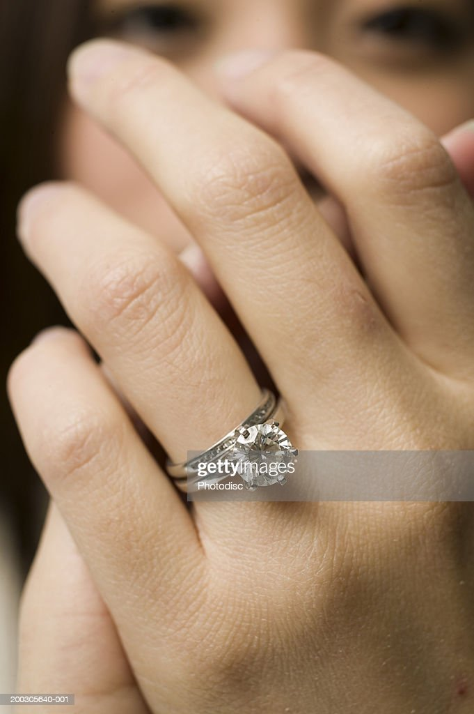Young woman, close up of ring on finger