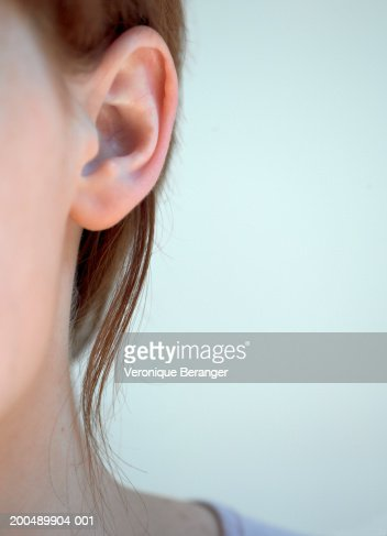 Young woman, close-up of ear