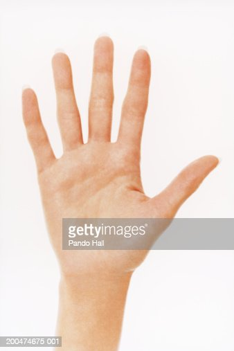 Young woman, close-up of hand