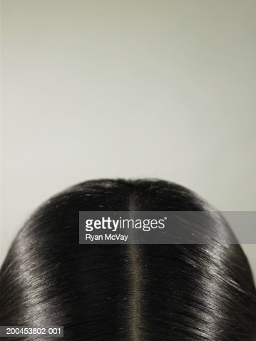 Young woman, close-up of top of head : Stock Photo