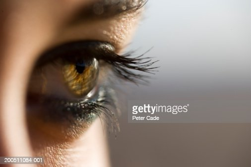 Young woman, close-up (focus on eye) : Stock Photo