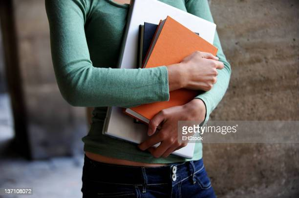 Young Woman College Student Holding Books and Computer