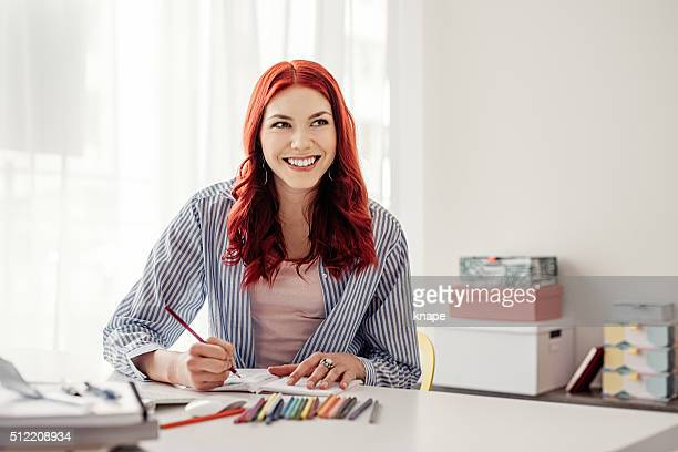 Young woman coloring adult coloring book
