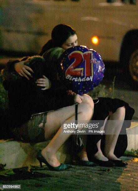 A young woman comforts her friend in Bristol city centre