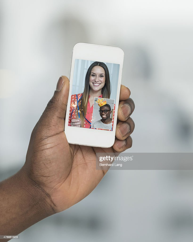 Young woman communicating with friend via phone