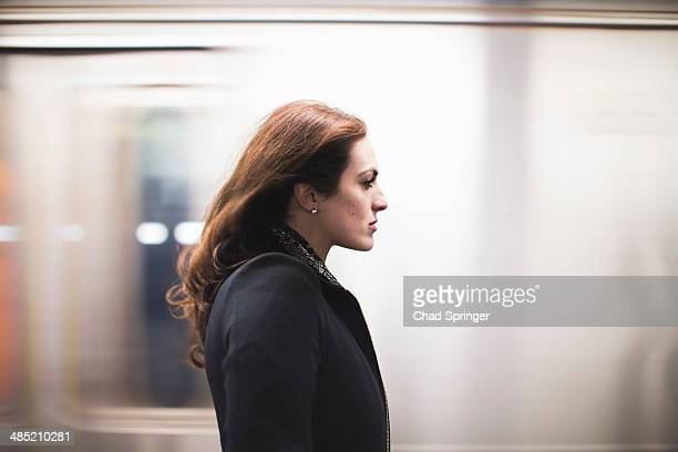 Young woman commuting on subway