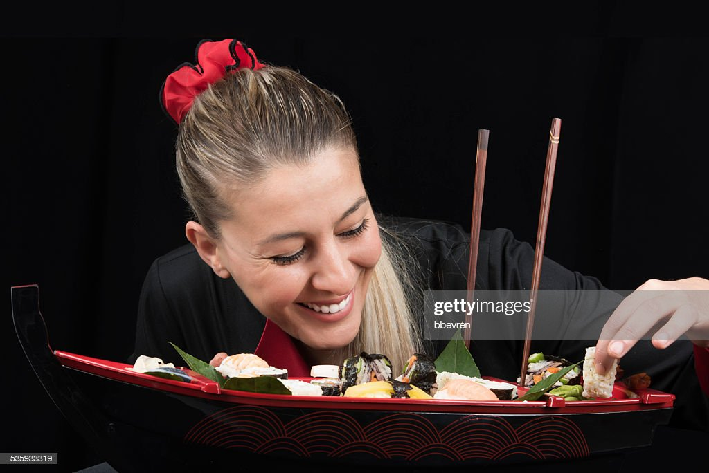 Young woman cook in uniform preparing luxury boat : Stock Photo