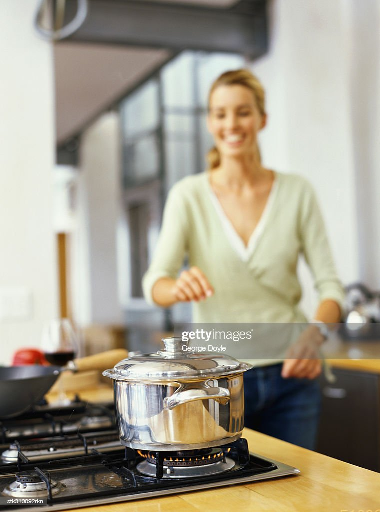 young woman cooking food in the kitchen : Stock Photo