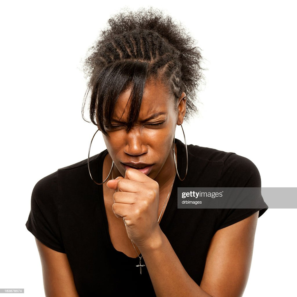 A young woman coughing roughly