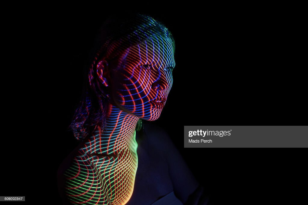 Young Woman Covered by futuristic Lines of Lights : Stock Photo