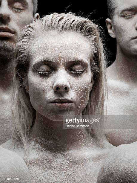 Young woman covered by white powder