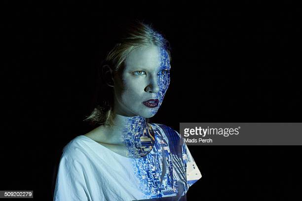 Young Woman Covered in Reflection of a Cityscape
