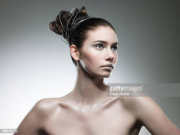 Young woman covered with silver make up