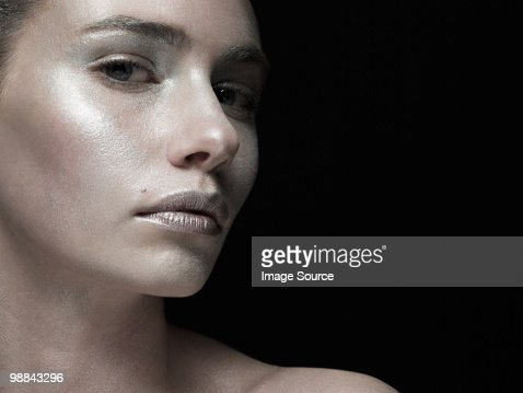 Young woman covered with silver make up : Stock Photo