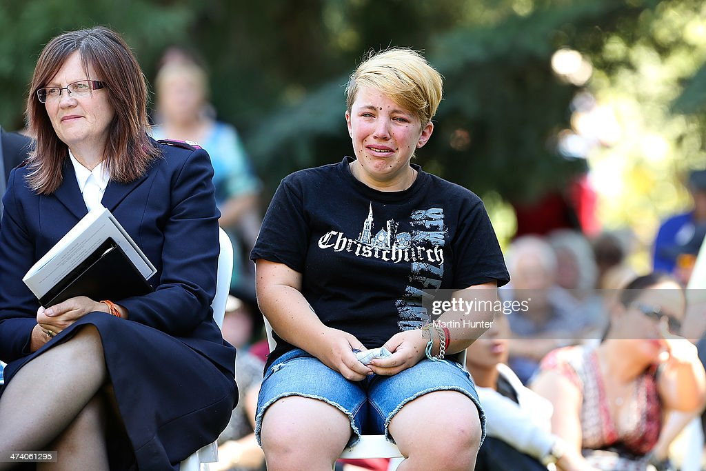A young woman cries during a Civic Memorial Service held in the Botanical Gardens for victims of the 2011 Christchurch Earthquakes on February 22, 2014 in Christchurch, New Zealand. The earthquake measuring 6.3 in magnistude devastated Christchurch killing 185 people and causing an estimated $40 billion in damage to the city's buildings and infrastructure.