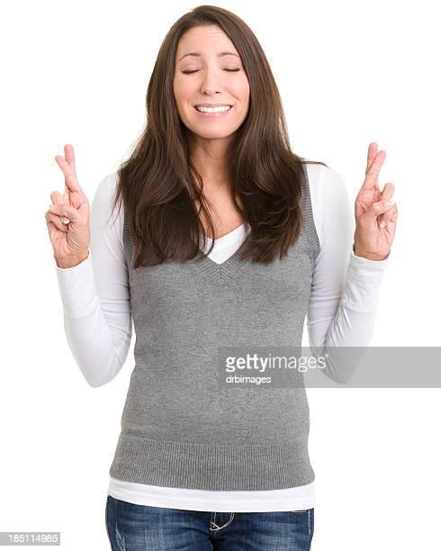 Young Woman Crosses Fingers Wishing