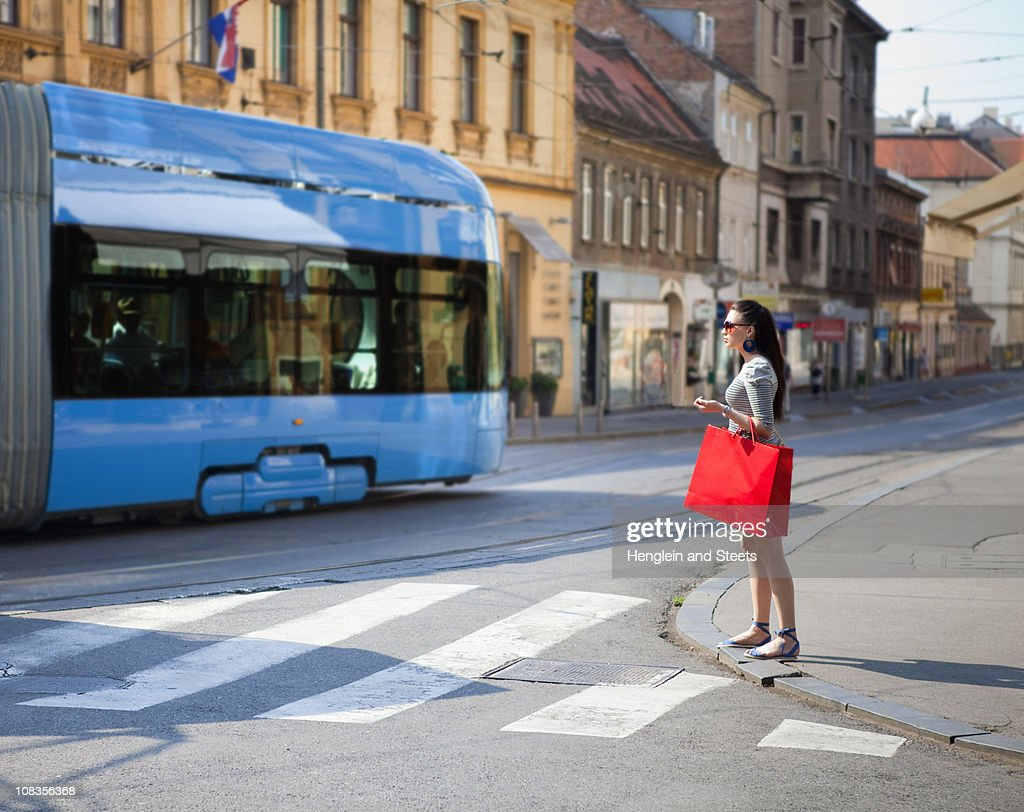 Young woman crossing road