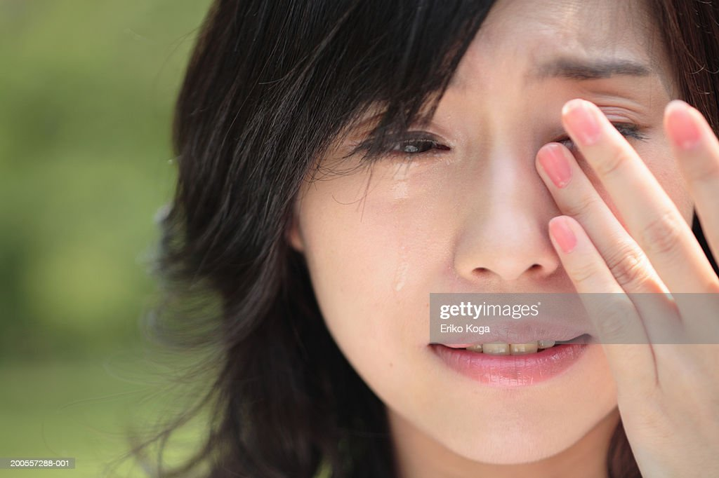 Young woman crying, close-up