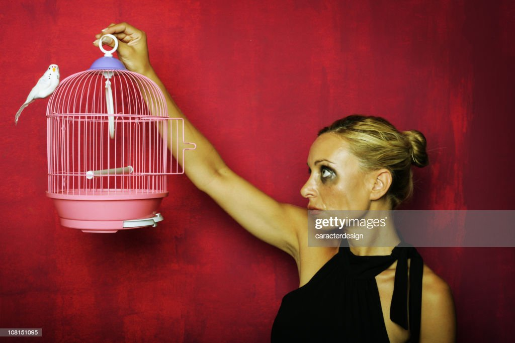 Young Woman Crying While Holding Bird Cage : Stock Photo