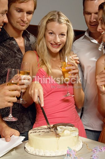 Young Woman Cutting Birthday Cake Friends Holding Champagne Portrait Stock Photo