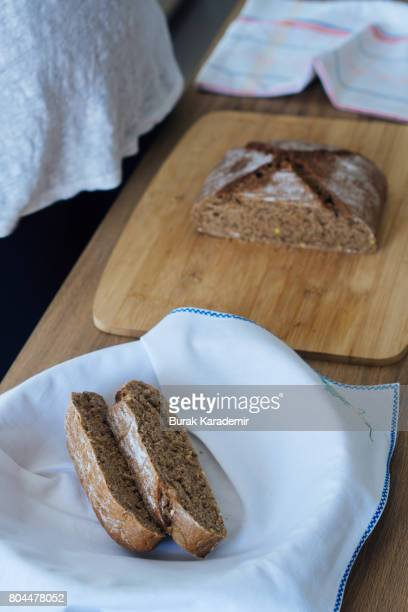Young woman cutting freshly made bread