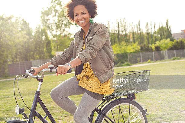 Young woman cycling in a Berlin Park