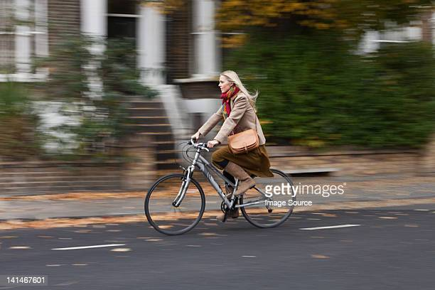 Young woman cycling on road