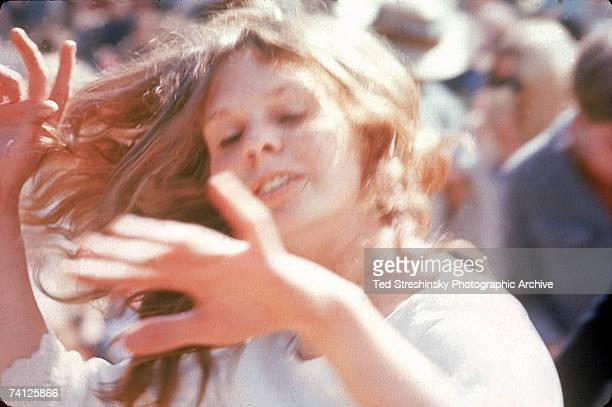 A young woman dances in the sun at the KFRC Fantasy Fair and Magic Mountain Music Festival held at the summit of Mount Tamalpais near San Francisco...