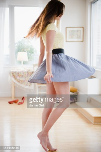 Young woman dancing at home