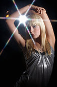 Young woman dancing in disco