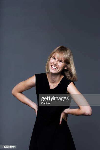 young woman dancing in front of studio background