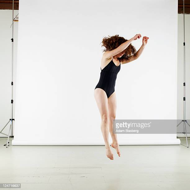 Young woman dancing in front of white background