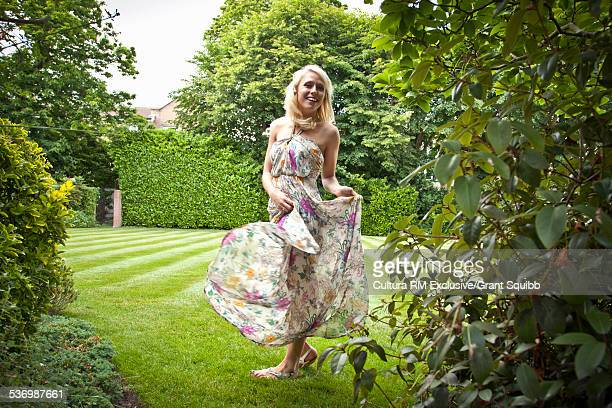 Young woman dancing in garden