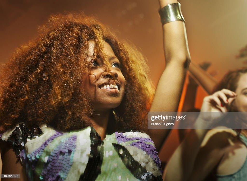 young woman dancing in nightclub : Stock Photo