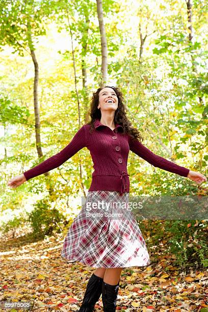 young woman dancing in the woods