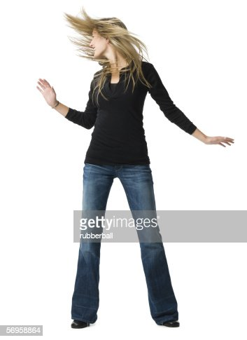 Young woman dancing : Stock Photo