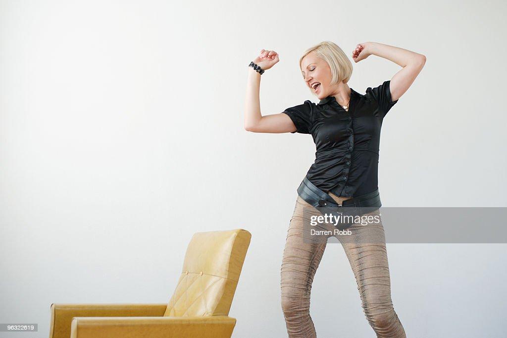 Young woman dancing, smiling : Stock Photo
