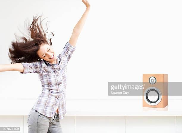 Young woman dancing to music