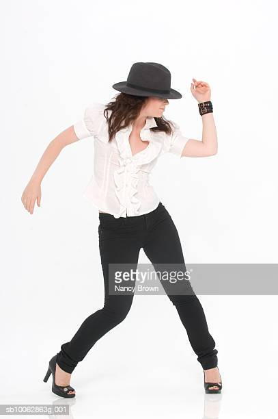 Young woman dancing, white background, studio shot