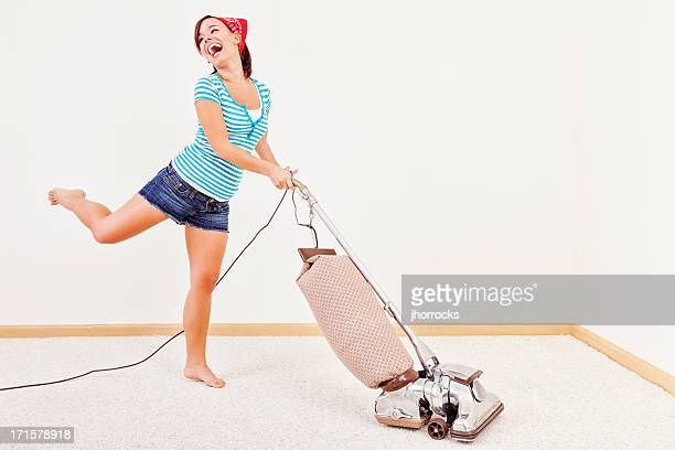 Young Woman Dancing with Vacuum Cleaner