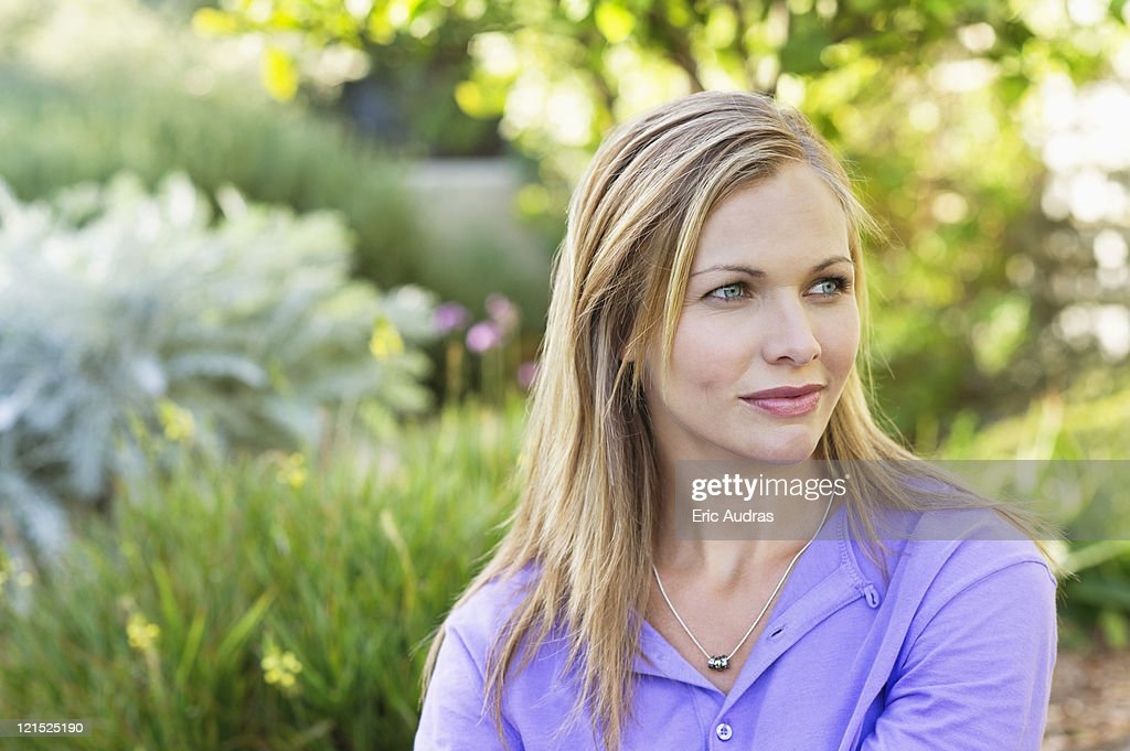 Young woman day dreaming : Stock Photo